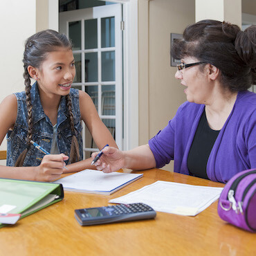 girl with tutor in tutoring session