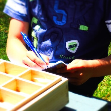toronto special needs tutor image for page - kid learning with notebook and box game