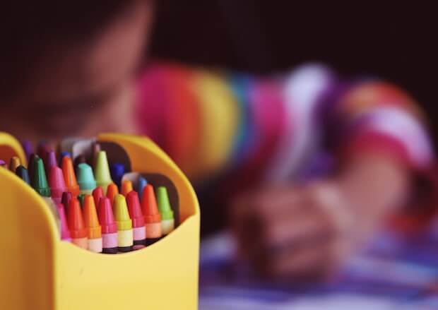 crayons and child colouring - educational teacher looping article featured image