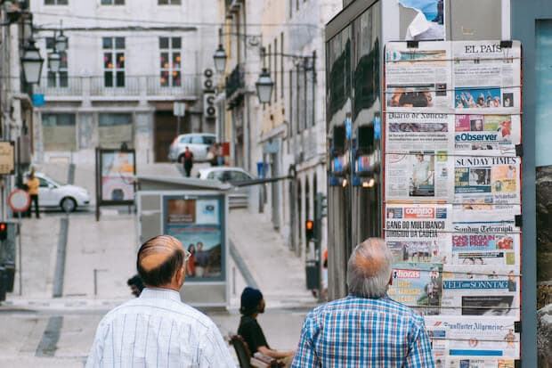 article featured image for teaching kids the elements of a news story - men standing at news stand